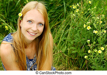 Young Woman Smiling in Flowers