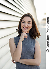 Young woman smiling in urban background