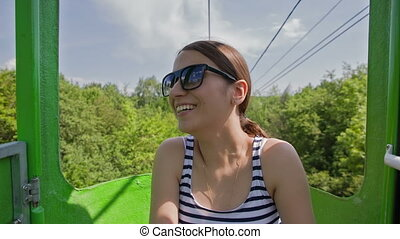 Young Woman Smiling Is In The Booth Of Rope Road