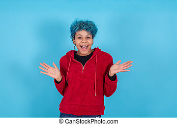 young woman smiling isolated on blue background with casual style