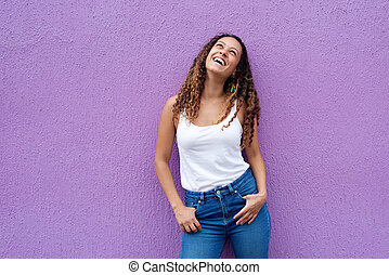 Young woman smiling looking up