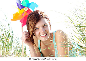 Young woman smiling outdoors