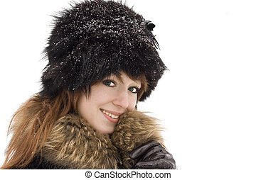 Young woman smiling under the snow isolated on white