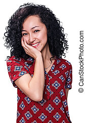 Young woman smiling with curly black hair