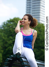 Young woman smiling with earphones