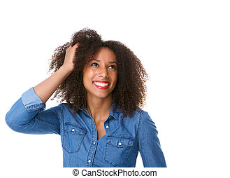 Young woman smiling with hand in hair