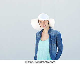 Young woman smiling with sun hat