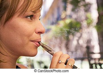 Young Woman Smokes E-Cig Electronic Cigarette