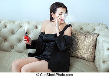 Young woman smokes.