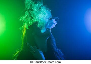 young woman smoking electronic cigarette