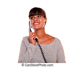Young woman speaking on phone looking to her right