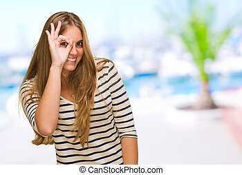 Young Woman Spies Through Hands