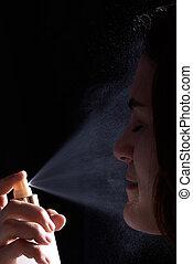woman spray face