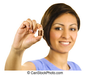 Young woman squeezes a stack of pennies.
