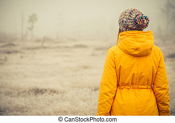 Young Woman standing alone outdoor Travel Lifestyle and...