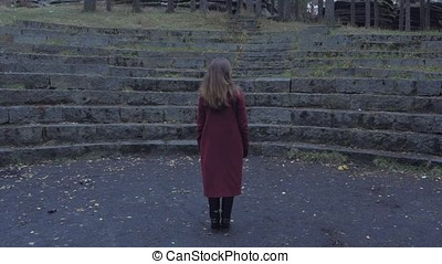 Young Woman standing alone outdoor wild forest and...