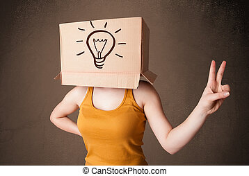 Young woman standing and gesturing with a cardboard box on...