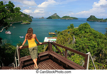 Young woman standing at overlook, Mae Koh island, Ang Thong National Marine Park, Thailand