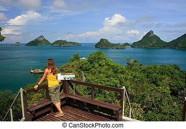 Young woman standing at overlook, Mae Koh island, Ang Thong National Marine Park, Thailand