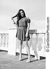 Young woman standing. Black and white concept.