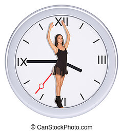 Young woman standing in center of clock