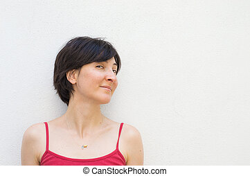 Young Woman Standing in Front of a White Wall