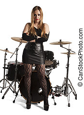 Young woman standing in front of drumkit