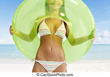 Young Woman Standing in Inflatable Ring