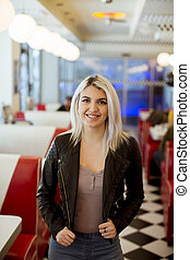 Young woman standing in the diner