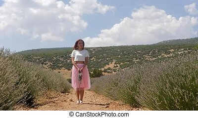 Young woman standing in the lavanda field