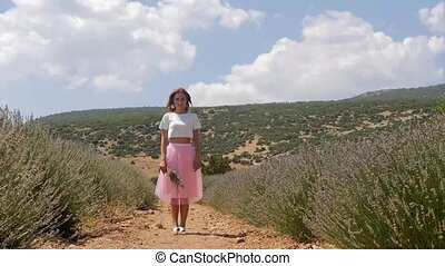 Young woman standing in the lavender field