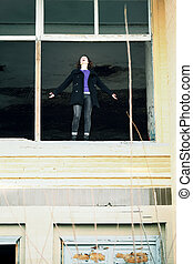 woman standing in the window