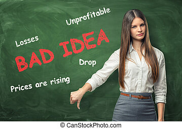 Young woman standing near big red words 'bad idea'