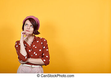 Young woman standing on chin thinking about question, pensive expression