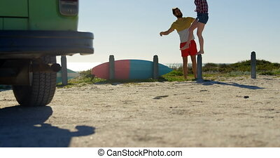 Young woman standing on concrete post at beach 4k - Young ...