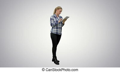Young woman standing on green background with digital tablet on white background.