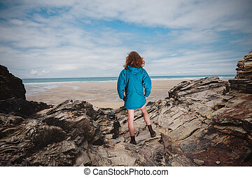 Young woman standing on the coast