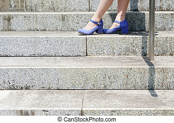 Young woman standing on the stairs