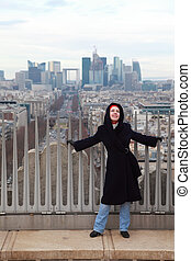 young woman standing on Triumfaly arch, view of La Defense...