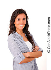 Young woman standing with arms crossed on white background