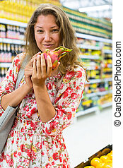 woman stands in a supermarket