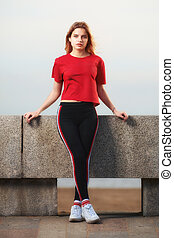 Young woman stands on beach. - European white teenage girl ...