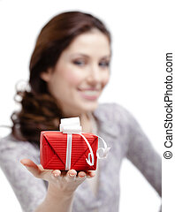 Young woman stretches out a gift
