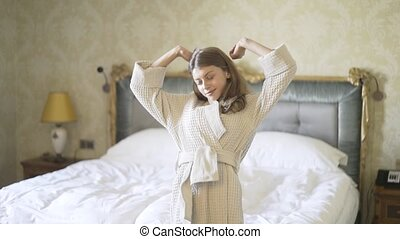 Young woman stretching in a hotel room