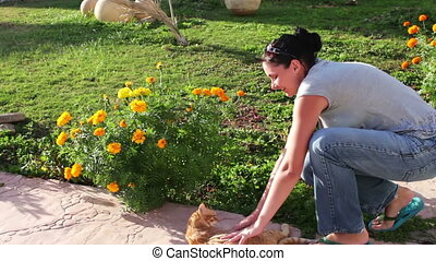 Young woman stroking cat
