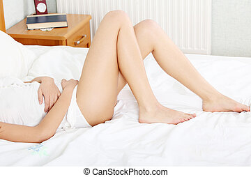 Young woman stroking her belly