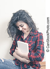 Young woman student smiling with book