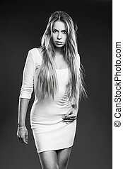 Young woman studio fashion portrait.