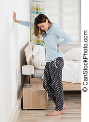 Young Woman Suffering From Back Pain