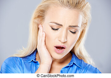 Young woman suffering from toothache - Beautiful young blond...